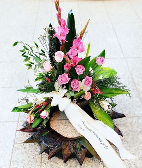 Picture of Danish style of Funeral Wreath standing on the floor with white lilies, pink gladiolus and roses and more-3 sizes.