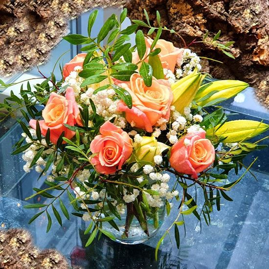 Picture of Romantic free spirit arrangement in glass vase (included) with roses, lilies, baby's breath- 4 colours.