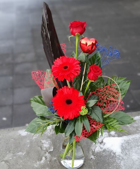 Picture of Valentine's  bouquet with red long stemed roses and gerbera daisy, greenery and heart..