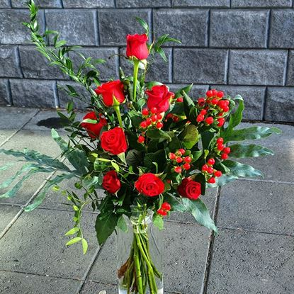 Picture of A romantic  bouquet with mix sizes red-orange-pink or white roses, berries, greenery.
