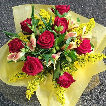 Picture of Vibrant and happy roses, solidago, alstroemeria mixed bouquet.
